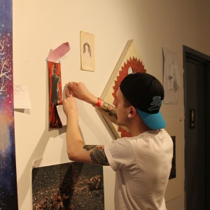 A student at Parsons puts the finishing touches on pieces for the silent auction/ Photo by Sara Sugar