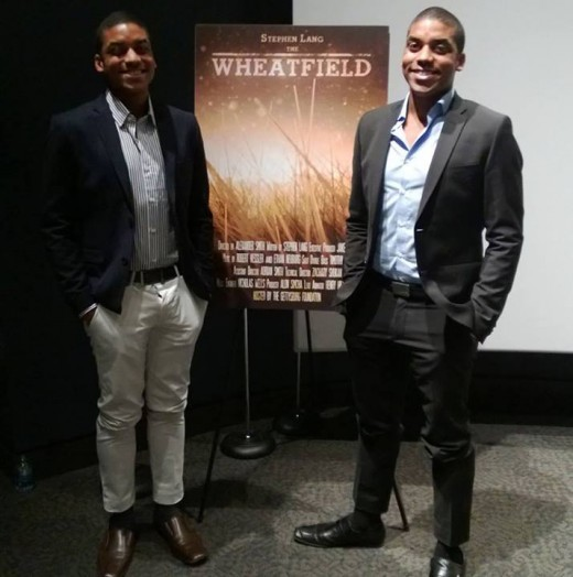 Alexander and Adrian Smith stand by the film's poster at its premiere.