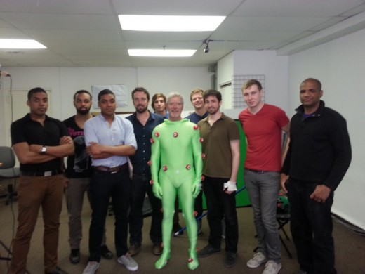 Stephen Lang (center) poses with some of the production team members at Omega Darling.